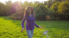 Happy african girl have fun in sunny park laughing, fooling, slow motion. - stock footage