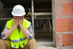 Distraught Construction Worker Stock Photos