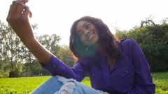 Happy african girl have fun in sunny park making selfie, slow motion. - stock footage
