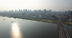 Wide angle aerial view of Yodogawa river and Osaka city Skyline metro city Stock Footage