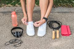 Female Runner Trying Running Shoes Getting Ready For Jogging - stock photo