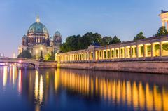 Berlin Cathedral at night with Spree river reflections of columns Stock Photos