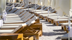 Tanning beds and umbrellas at the beach in Croatia. Stock Footage
