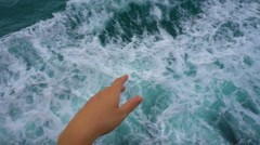 Male and female hands holding together on moving boat against water Stock Footage