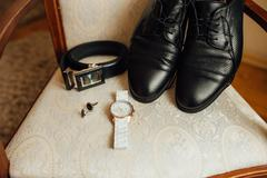 Groom set clothes. Watch, shoes, bow tie Stock Photos