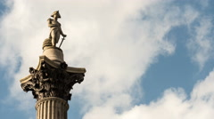 Time lapse: Nelson's Column, Trafalgar Square, London with streaming clouds Stock Footage