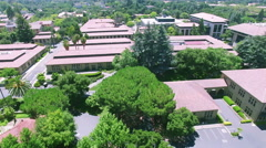 4K above buildings stanford university Stock Footage