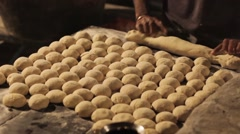 Indian woman makes hand made bread Stock Footage