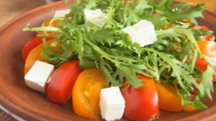 Close up of vegetable salad with frieze and tomato Stock Footage
