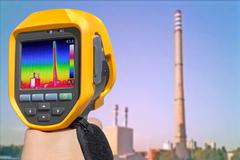 Record heat emission at the Chimney of energy station with infrared thermal c Stock Photos