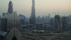 Panning up view of Downtown skyline & Burj Khalifa at sunset, Dubai Stock Footage