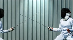 Fencing duel side view Stock Footage