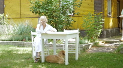 Woman sitting at the outdoor tables at the dacha. Stock Footage
