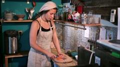 Woman cutting raw fresh carrot on chopping board Stock Footage