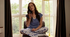 4k, Young attractive woman talking on her cellphone at home. Stock Footage