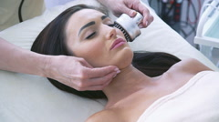 Head of woman having a stimulating facial treatment Stock Footage