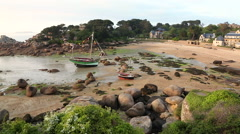 Walking on beach with boats, Ploumanach, Cote de Granit Rose Stock Footage