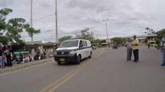 Latin American police van drives up street (HD) Stock Footage