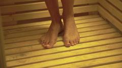 Portrait of woman's legs. Lady undressing in sauna Stock Footage