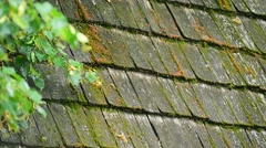 Architecture detail with old and weathered wooden roof tiles Stock Footage
