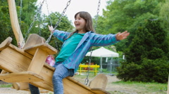 Smiling girls having fun at playground. Children playing outdoors in summer Stock Footage