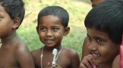 Village children in India smile and play in front of the camera, close up, - stock footage