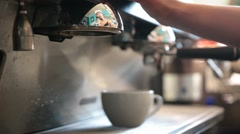 Young barista preparing coffee in a cafe Stock Footage