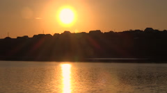 Sunrise Over the Lake. Background Silhouettes of One-Story Farmhouses. Stock Footage
