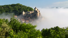 Early morning mist, Chateau de Castelnaud, Castelnaud, Dordogne, Aquitaine Stock Footage