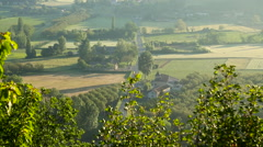 View looking down on French country road with cars Stock Footage