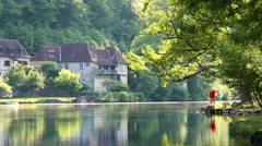 Man admiring Dordogne River at Beaulieu sur Dordogne, Correze, Limousin Stock Footage