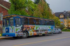 GRAMADO, BRAZIL - MAY 06, 2016: nice and colorfull bus parked in the street in Stock Photos