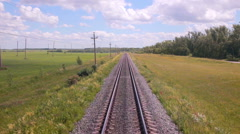 Railroad. Railway tracks from moving train. Travelling background Stock Footage