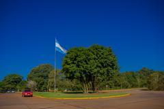 IGUAZU, ARGENTINA - MAY 14, 2016: argentinas flag waving at the national park of Stock Photos