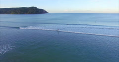 Aerial of whangamata beach paddleboarder, Coromandel, New Zealand Stock Footage