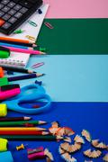 School or office stationery on colorful background. Back to School. Frame, copy Stock Photos