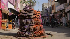 Pile of cow dung on street for Holi festival,Ujjain,India Stock Footage