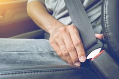 Fasten the car seat belt. Safety belt safety first Stock Photos
