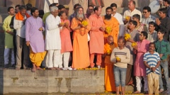 Ceremony with hindu priest and pilgrims throwing flowers in river,Ujjain,India Stock Footage