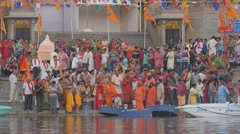 Ceremony with priests pouring milk in river,Ujjain,India Stock Footage