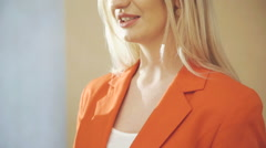 Pretty woman in red jacket speaking, smiling and noodling Stock Footage