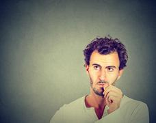 Worried man sucking his thumb Stock Photos