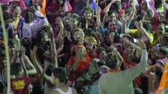 People celebrate Holi with throwing flowers,Ujjain,India - stock footage