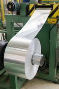 Aluminum roll for press molding. Stock Photos