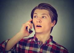 Surprised man talking on mobile phone Stock Photos