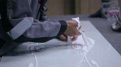 Man hands decorating glass in workshop Stock Footage