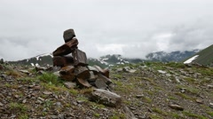 Piles of stones Mark of the right way in High Snowy mountains Stock Footage