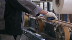 Carpenter works with wood. Woodworking mechanism. Circular sawing machine - stock footage