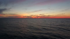 Aerial amazing shot of beautiful ocean sunset above sea Stock Footage