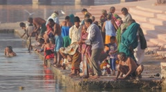 Pilgrims washing and put candle in river,Ujjain,India Stock Footage